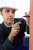 Mason with plumb line — Stock Photo
