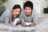 Couple playing a video game together — Stock Photo