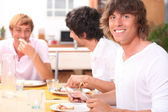 Guys eating bacon — Stock Photo