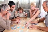 A family making a puzzle — Stock Photo