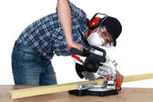 Man using a mitre saw — Stock Photo