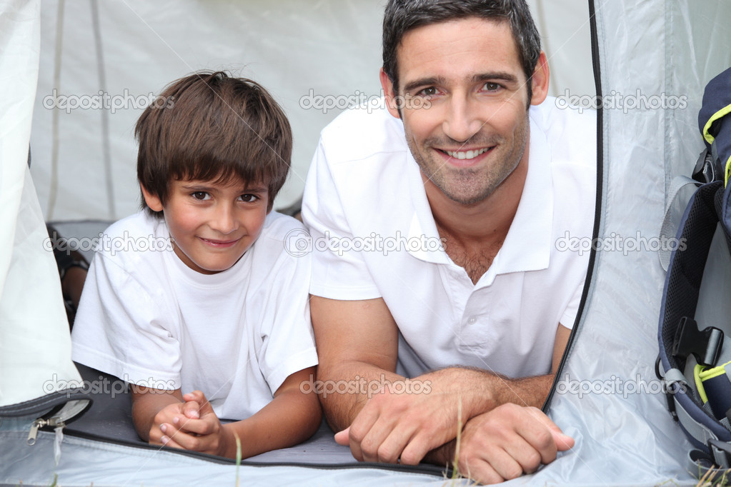 Father and son camping in a tent — Stock Photo #8081095