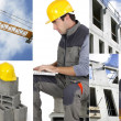 Stock Photo: Photo-montage of a building worker
