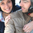 Smiling couple having a bike ride — Stock Photo