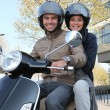 Friends having ride on scooter — Stock Photo #8101039