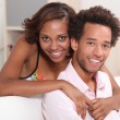 African couple relaxing at home — Stock Photo
