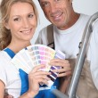 Couple choosing colours - Stock Photo