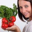 Lady posing with tomatoes and parsley — Stock Photo #8101507