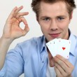 "Young man showing a ""four of a kind"" poker combination — Stock Photo #8101550"