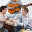 Stock Photo: Three friends playing musical instruments