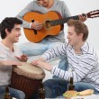 Three friends playing musical instruments — Stock Photo