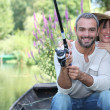 Romantic couple fishing on the river — Stock Photo