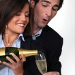 Happy couple drinking champagne — Stock Photo