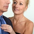 Wife helping husband with tie — Stock Photo #8101690