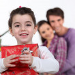 Young girl with a Christmas present — Stock Photo #8101695