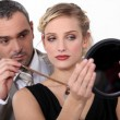 Make-up artist with model — Stock Photo
