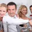 Couple dining with friends — Stock Photo