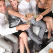 Two young couples with champagne flutes — Stock Photo