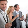 Stock Photo: Four colleagues drinking champagne