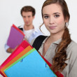 Students carrying folders — Stock Photo