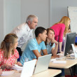 Young using computers in class — Stock Photo #8101903