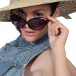 Woman wearing straw hat and sunglasses — Stock Photo #8101914