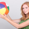 Teenage girl holding inflatable beach ball — Stock Photo #8102000