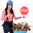 Woman holding stop sign — Stock Photo