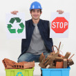 Construction worker encouraging to recycle waste — Stok fotoğraf
