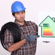Stock Photo: Young heating engineer looking sad