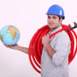 Plumber with globe in hand — Stock Photo #8102332