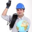 Electrician holding light bulb and globe — Stock Photo #8102338
