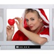 Woman wearing a Christmas costume behind a TV screen — Stock Photo