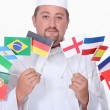 Chef holding flags — Stock Photo