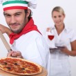 Pizzcook and waitress — Stock Photo #8102451