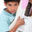 Stock Photo: Portrait of child with guitar
