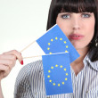 Stock Photo: Pretty womwith EuropeUnion flags