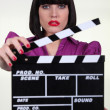 Sexy actress with clap of cinema — Stockfoto