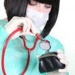 Nurse with surgical mask with stethoscope on purse - Stock Photo