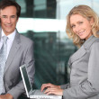 Two executives working outside an office building — Stock Photo #8102889