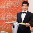 Stock Photo: Waiter on service