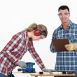 Craftsman and craftswoman working together — Stockfoto