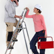 Craftsman working with his female apprentice — Stock Photo