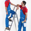 Stock Photo: Two decorators in uniform