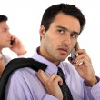 Two young businessmen talking on their cells — Stock Photo #8103312