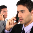 Young businessmen on the phone — Stock Photo