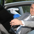 Architect sitting in his car with a laptop — Stock Photo