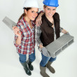 Two female builders posing — Stock Photo