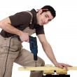Handyman using a power tool — Stock Photo #8105942