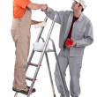 Decorators shaking hands - Stock Photo